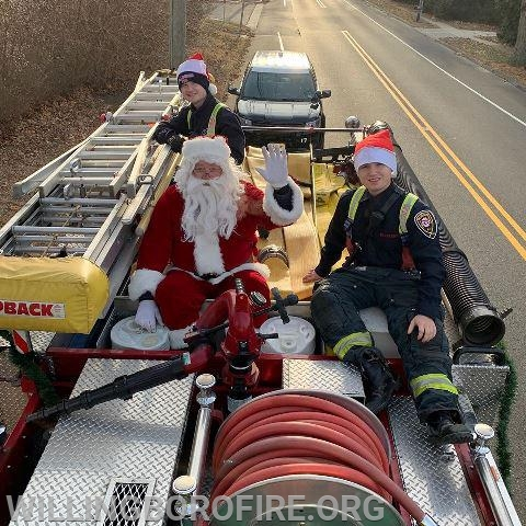 Santa Claus making his way through town with Candidates A. Friddell and E. Friddell